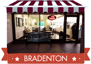 red awning with photo of bradenton location and red banner