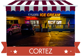 red striped awning over photo of shop at night with red banner reading Cortez Location